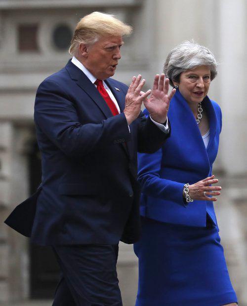Donald Trump trifft Theresa May: Gemeinsamkeiten und Differenzen.ap