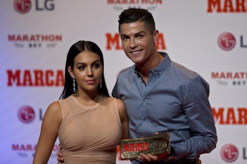 Ronaldo (im Bild mit Freundin Georgina Rodriguez) spielte in Südkorea nicht. AP