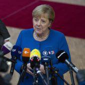Merkel und Macron loben neuen Deal