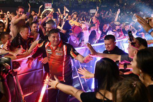 Die 3000 Darts-Fans werden auch diesmal wieder für eine ausgelassene Party-Atmosphäre bei der Weltmeisterschaft im Ally Pally sorgen.APA
