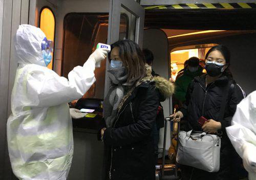 Alle Flüge und Züge aus Wuhan wurden am Mittwoch gestoppt. Die Bewohner dürfen die Millionenstadt nur noch mit einer Sondergenehmigung verlassen.AP