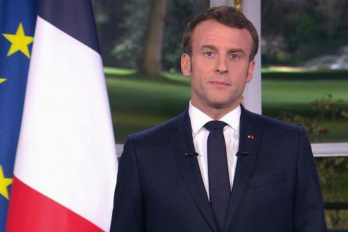 Der französische Präsident will an der umstrittenen Reform festhalten. AFP