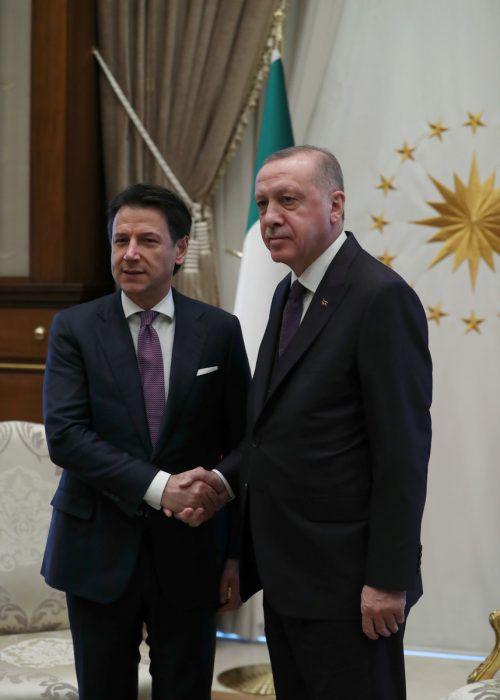 Erdogan und Conte wollen beide nach Berlin reisen. reuters