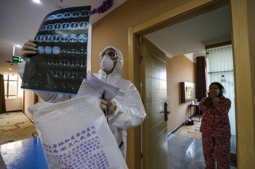 Lungenuntersuchungen mittels Computertomographie stehen in Wuhans Krankenhäusern an der Tagesordnung. AFP