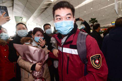 Maskenpflicht in vielen Städten: Mehr als 300 Millionen Menschen sind betroffen. AP