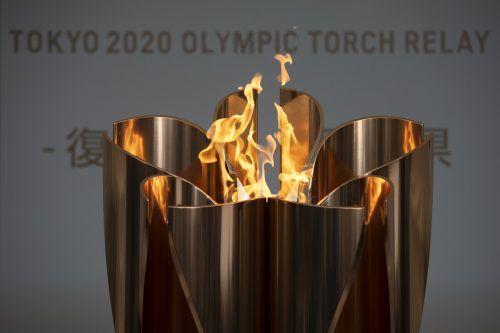 Die Olympische Flamme wird mit einem Jahr Verspätung in Tokio brennen.ap