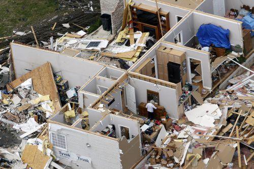 Zahlreiche Häuser und Gebäude sind zerstört oder schwer beschädigt worden. AP