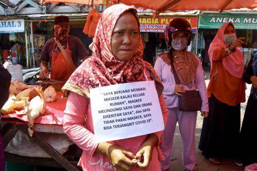 """""""Public Shaming"""" in Indonesien: """"Ich werde eine Maske tragen ..."""" APA"""