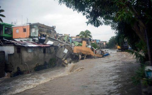 """Tropensturm """"Laura"""" ist schon über die Dominikanische Republik gezogen. In der Hauptstadt Santo Domingo kam es zu starken Überschwemmungen. AFP"""