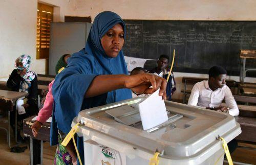 7,4 Millionen Wähler waren zur Präsidentschafts- und Parlamentswahl im Niger aufgerufen. Favorit ist ein Vertrauter des bisherigen Staatschefs. AFP