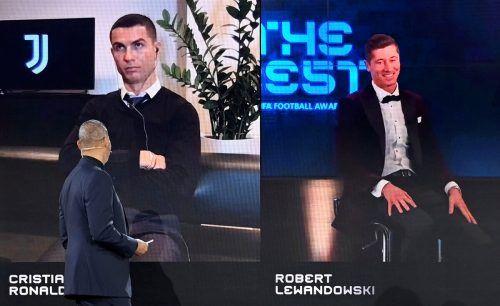 Ein sichtlich gelöster Robert Lewandowski (rechts) freute sich über seine erste Wahl zum weltbesten Fußballer. Links Cristiano Ronaldo, der 2017 letztmals gewann.ap