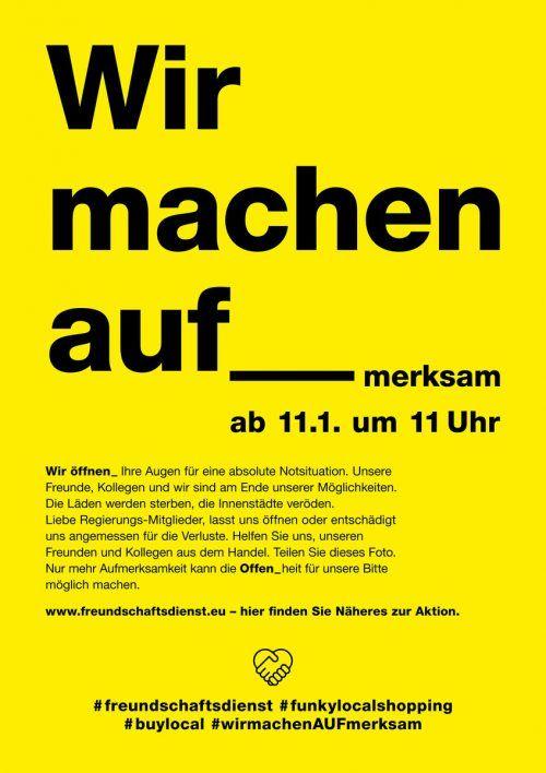 Mit auffälligen Plakaten sollen Händler auf ihre Lage aufmerksam machen. FD