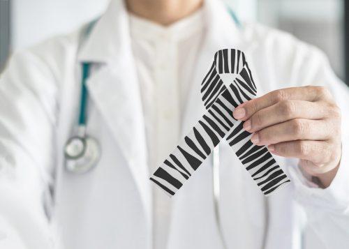 Ähnlich wie die Aids-Schleife, ist die Zebra-print-Schleife ein Symbol für die seltenen Erkrankungen. Adobe Stock