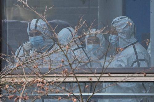 Mitglieder des WHO-Teams, welche die Ursprünge von Covid19 untersuchen, besuchen das Zentrum für Tierkrankheiten in Wuhan. AFP