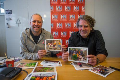 Udo Neyer (li.) und Wolfgang Schmieder zeigen Fotos von den Waisen. VN/PS