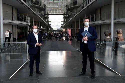Sowohl der CDU-Chef als auch der CSU-Vorsitzende möchten für das deutsche Kanzleramt kandidieren. AFP