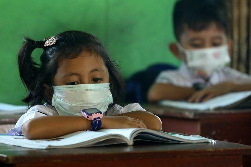 Statt stundenlang über den Büchern zu sitzen, sollen sich chinesische Schulkinder nun laut Regierungsanordnung mehr sportlich bewegen. afp