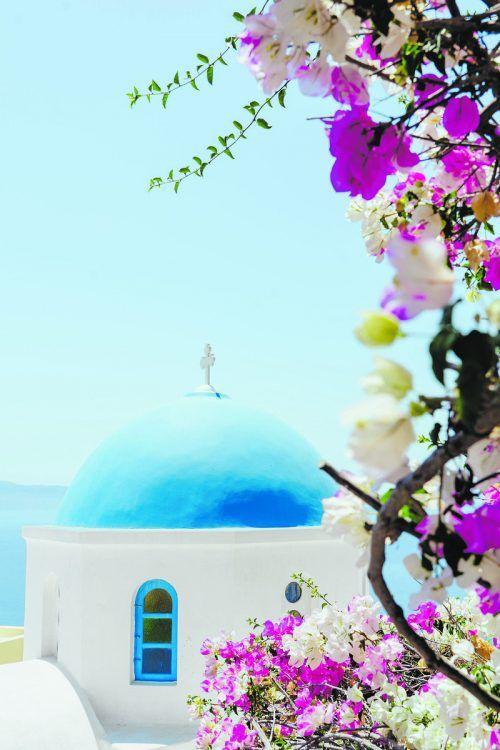 Griechenland ist berühmt für die weißen Häuser mit den blauen Dächern.Xuan Nguyen/Unsplash