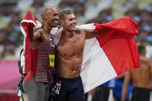 Damian Warner und Kevin Mayer ließen sich nach Gold und Silber im Zehnkampf bei den Sommerspielen feiern.ap
