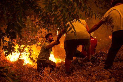 Der Kampf gegen die Waldbrände bringt die Menschen in Griechenland an ihre Grenzen. AFP