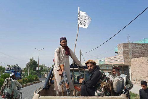 Die weiße Fahne der Taliban weht schon nahezu im ganzen Land. Mit Kabul fällt bald die letzte Stadt an die radikalen Islamisten. AFP