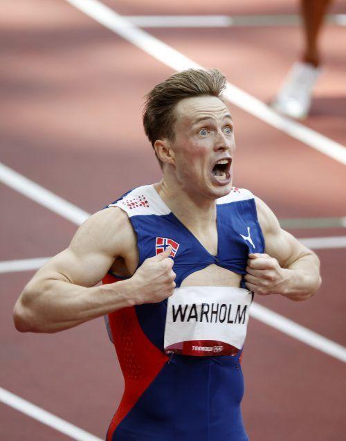 Karsten Warholm macht nach dem fantastischen Weltrekord bei seinem Goldlauf über 400 m Hürden große Augen.Reuters, AP, APA,