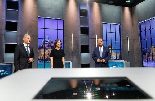 SPD-Spitzenkandidat Olaf Scholz (l.) führt derzeit die Umfragen vor Armin Laschet (CDU) und Annalena Baerbock (Grüne) an.Reuters